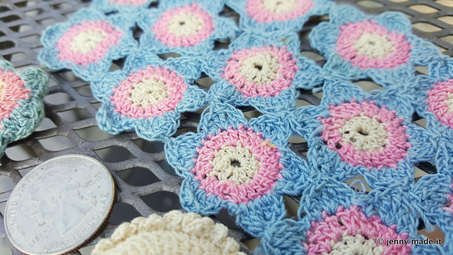 close up mini crocheted blanket and pillows