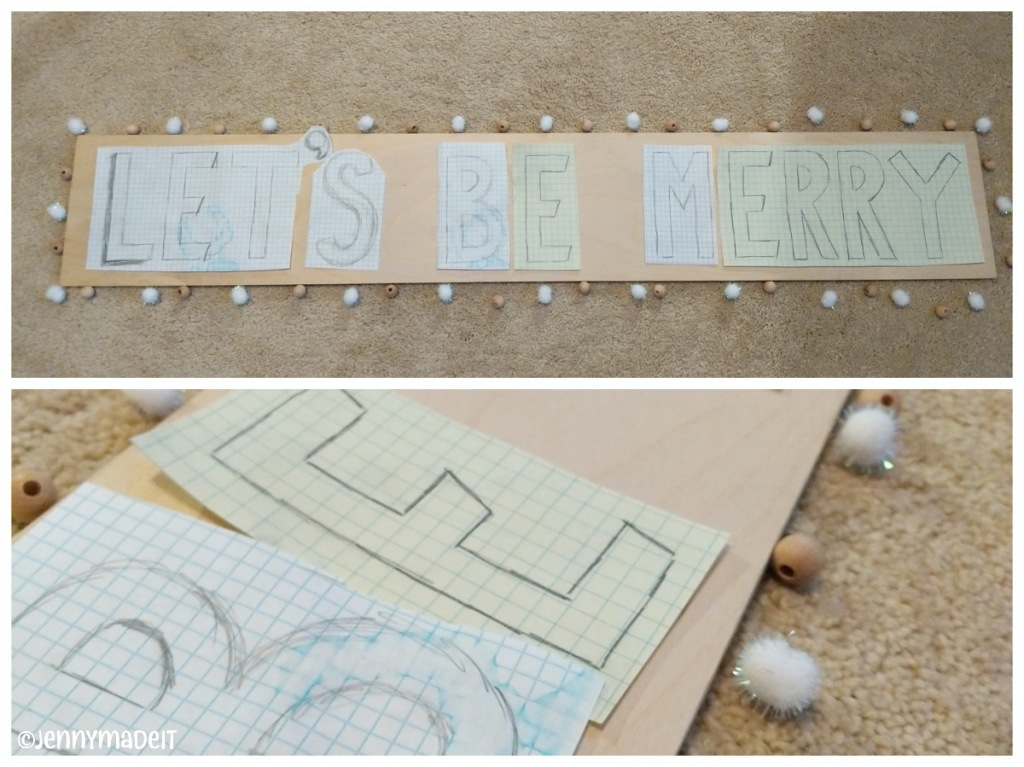Photo of wood with sketched out letters on paper