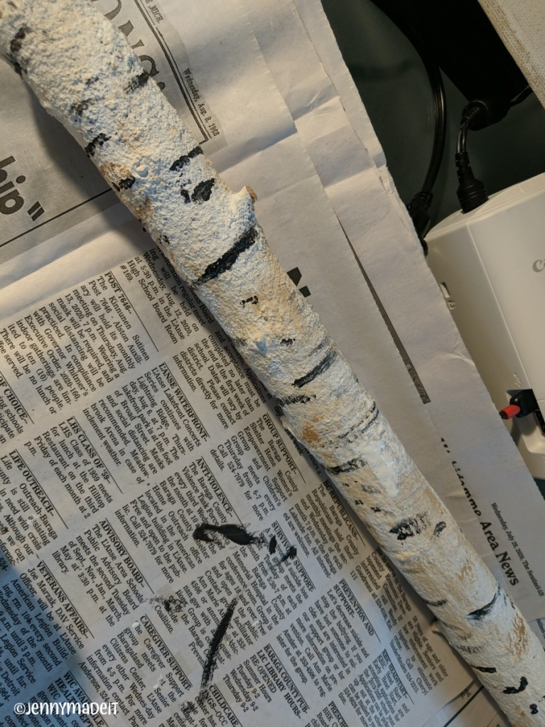 Photo of one branch painted to resemble a birch log