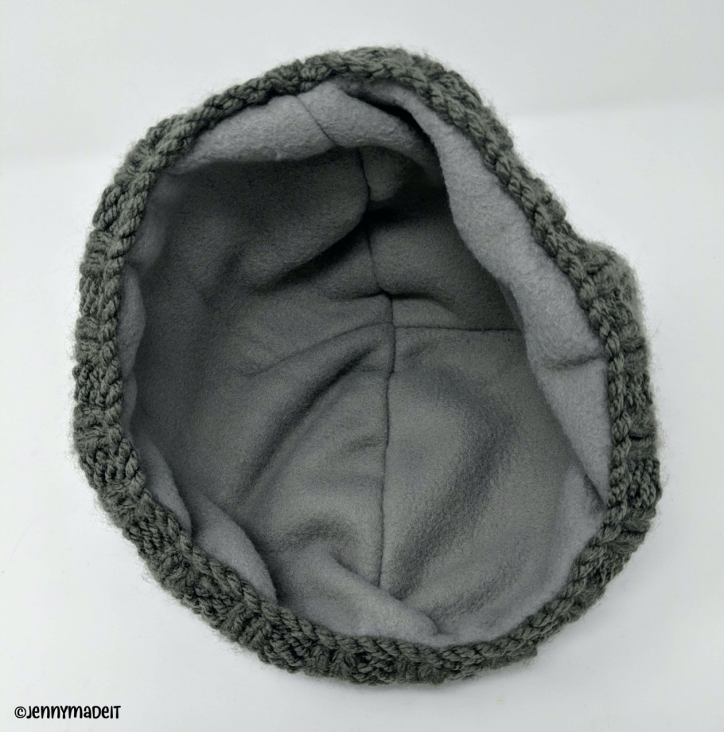 This is a photo of a knit hat with a sewn in fleece lining.
